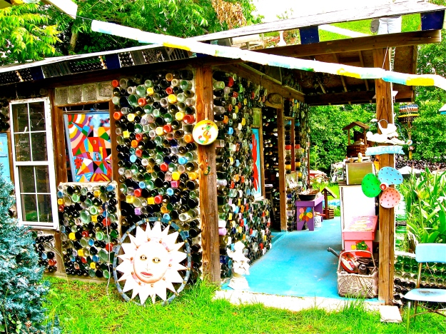 The outside of another house she built from recycled  wood and bottles