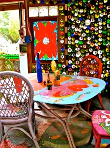Inside each bottle house is more of Mary's art -- painted glass and furniture.
