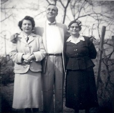 My aunt, uncle and grandmother in my great-grandmother's backyard. South Norfolk, 1940s.